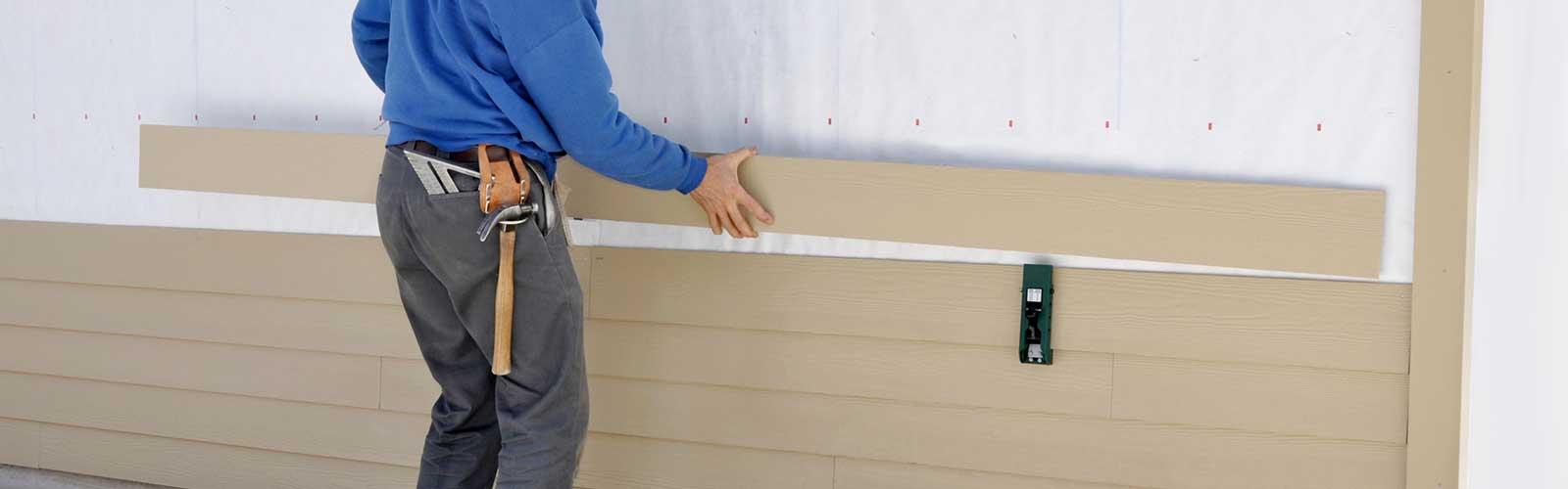 Carpenter Installing Siding