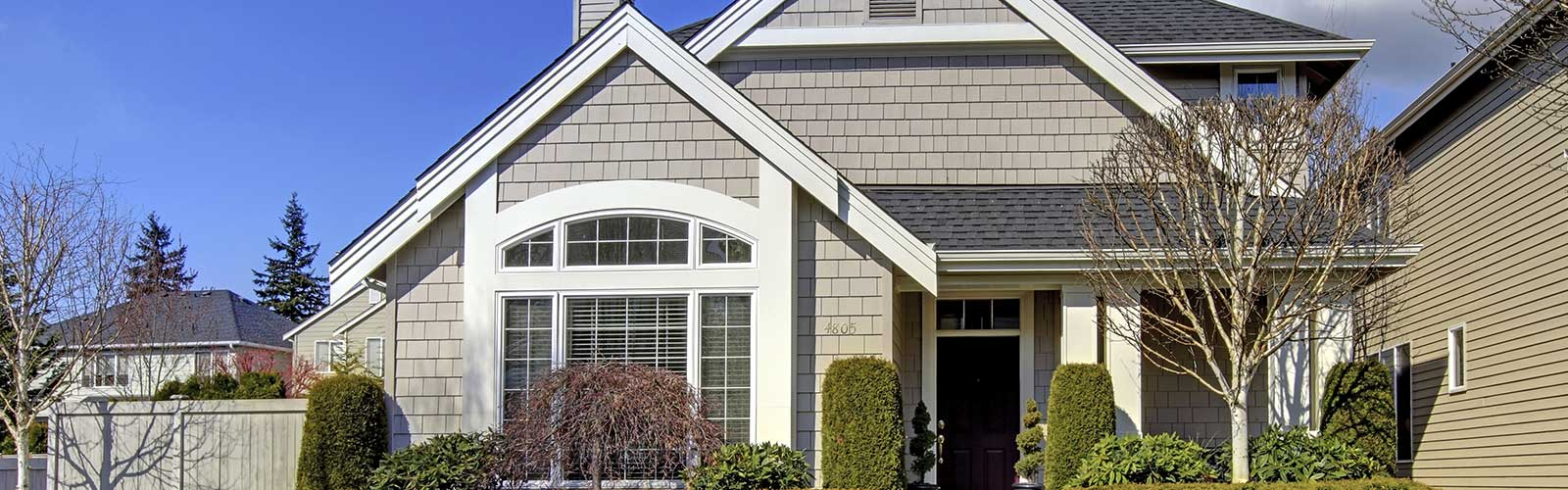 Classic New American House Exterior in the Spring