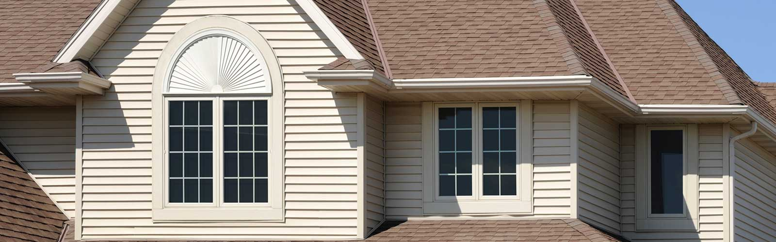 Perfect Brown Home with Gabled Architectural Asphalt Roof and Vinyl Siding